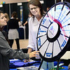 KEVIN HARVISON | Staff photo<br /> Pictured from left, Talihena High School Student Maria Armendariz spins the Kiamichi Technology Center prize wheel while KTC Counselor Shelly Byrd looks on during a career fair held at the Southeast Expo Wednesday.