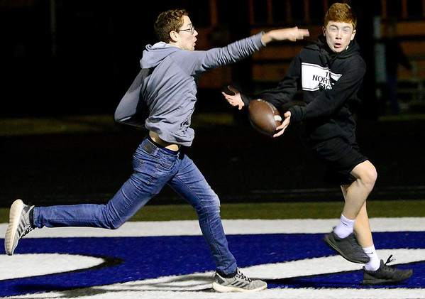 KEVIN HARVISON | Staff photo McAlester High School students Caleb Robinson, left covers Layton Bass, right during a pick up game of football before the start of the MHS football game at Glenpool Friday night. The pass was completed in the endzone.