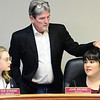 KEVIN HARVISON | Staff photo<br /> McAlester Mayor John Browne, center, gives acting mayor, McAlester High School Senior Mikayla Walker, right some council instructions as, Gabbie Williams, left, listens in.