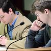 "KEVIN HARVISON | Staff photo<br /> Pictured far right, ""acting"" city counsilman Zack Lerblanc looks over a proposal during a mock city council meeting for MHS Student Government Day Thursday."