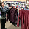KEVIN HARVISON | Staff photo<br /> Sandy Keener, with Shared Blessings, restocks some clothes.