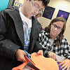 KEVIN HARVISON | Staff photo<br /> Amanda Grantham, right, Emerson Elementary STEAM teacher, helps a student with a class project.