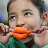 Xochitl Vargas models her playdough lips she created for fun.