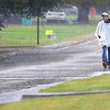 KEVIN HARVISON | Staff photo <br /> Pedestrians had to tread water as they made their way around town Wednesday.