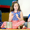 Kevin Harvison | Staff photo<br /> Pictured fromleft are Emerson Elementary fourth grade students, Brooklyn Mullins, Julia Haase and Dylan Reedprepare for their opportunity to perform during Friday's Veterans Day Assembly at Emerson.