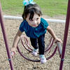 Kevin Harvison | Staff photo<br /> Washington Early Childhood / Kibios Head Start Center student Melissa Rico plays on a piece of the schools playground equipment.