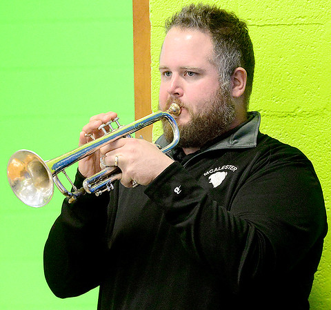 Kevin Harvison | Staff photo<br /> Mark Price plays Taps at the end of the Friday Veterans Day Assembly at Emerson Elementary School.