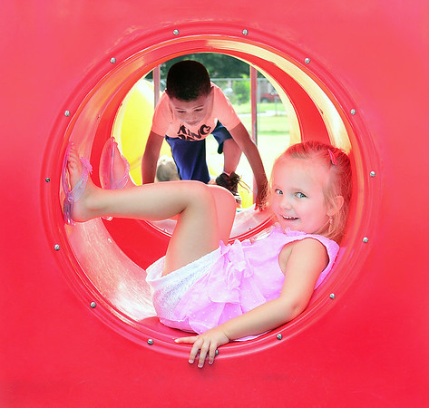 Kevin Harvison | Staff photo<br /> Washington Early Childhood / Kibios Head Start Center student Aphaylla Thompson, forground sits inside of a tube as Warren Glazier looks to enter during recess on the Washington playground.