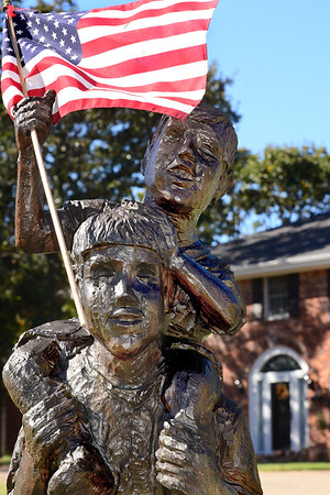 Kevin Harvison | Staff photo<br /> This wooden sculpture at a home on Country Club Road proudly boasts an American Flag.