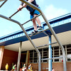 Kevin Harvison | Staff photo<br /> Washington Early Childhood / Kibios Head Start Center student Colby Beashears gets a view from above during recess on the Washington playground.
