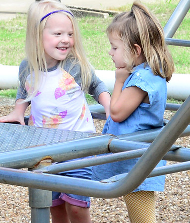 Kevin Harvison | Staff photo<br /> Washington Early Childhood / Kibios Head Start Centerstudendts pictured from left, Isabella Boyd and McKenzie Collins have a discussion on the playground.