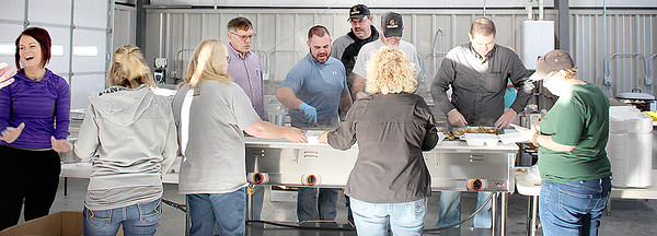 Submitted photo | <br /> Pittsburg County elected officals serve the annual Thanksgiving Dinner Thursday.