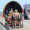 Kevin Harvison | Staff photo<br /> A team of mules pulls a wagon south bound on U.S. Highway 69 near Shady Point exit.