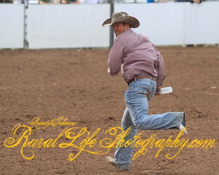 """""""Cow Milking"""" Shane Erickson lost a boot running to the judge ."""