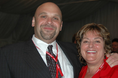 "NESDA President Fred Paradis CSM gets a hug from ""the hug lady,"" Fay Wood EHF."