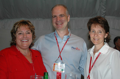 NESDA Membership & Marketing Chair Fay Wood EHF visits with PlusOne Solutions staff.