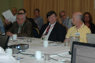 Ed Clingman, Jim Fellows CET/CSM, and Dave Prince listen to reports at the NESDA Board meeting.