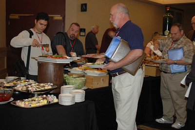 Convention-goers fill their plates in the buffet line at the Thomson luncheon.