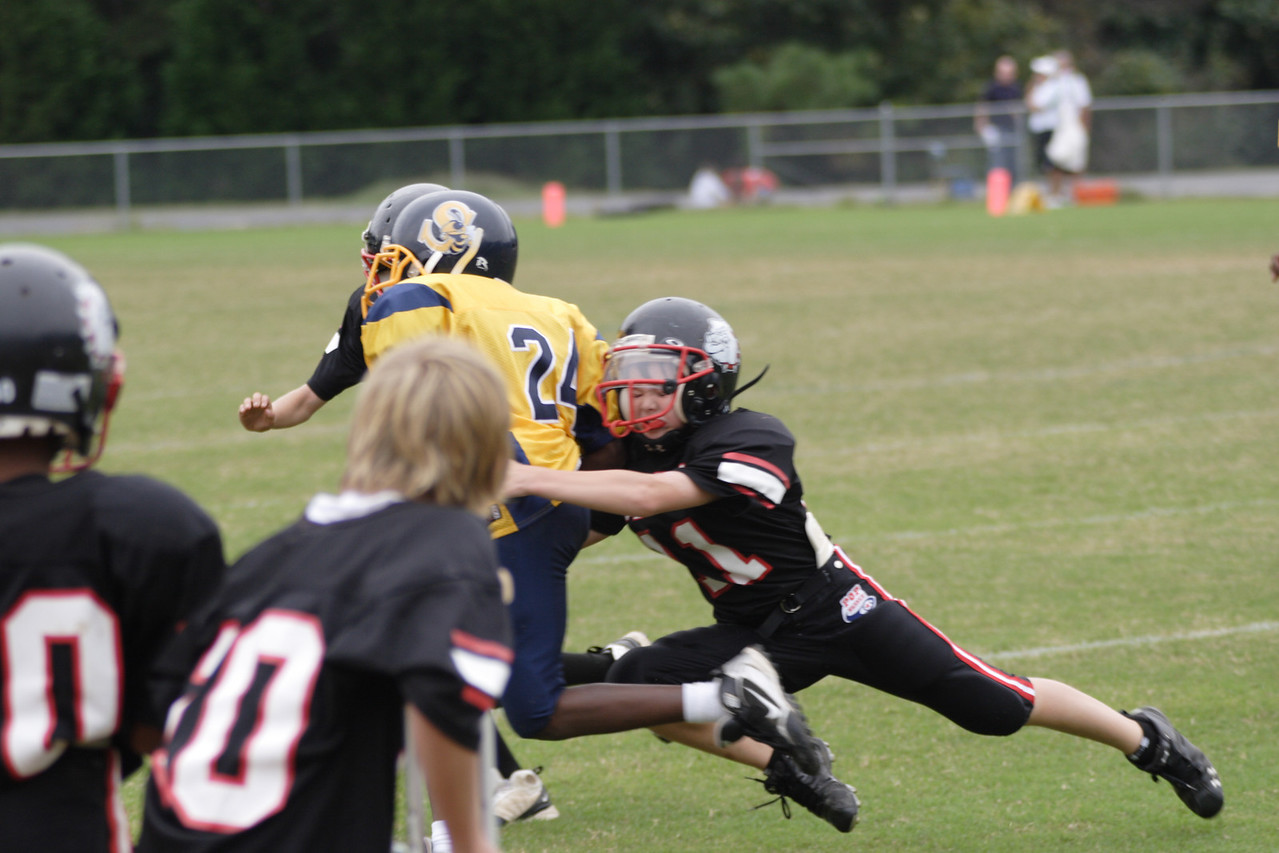 Harrison makes the diving tackle
