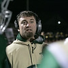 Nashoba Regional High School football hosted Groton Dunstable Regional high School on Friday night, Nov. 15, 2019. NRHS's Assistant Coach Kevin Berthiaume talks to the players during a timeout. SENTINEL & ENTERPRISE/JOHN LOVE
