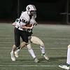 Nashoba Regional High School football hosted Groton Dunstable Regional high School on Friday night, Nov. 15, 2019. NRHS's #33 Ethan Revell tries to take down GDRHS's #15 Tim Stark. SENTINEL & ENTERPRISE/JOHN LOVE