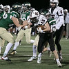 Nashoba Regional High School football hosted Groton Dunstable Regional high School on Friday night, Nov. 15, 2019. NRHS's #75 Owen Fitzsimmons and #21 Kenny Frommer try and take down GDRHS's #15 Tim Stark. SENTINEL & ENTERPRISE/JOHN LOVE