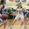Nashoba Regional High School girls' basketball played Acton-Boxborough Regional High School on Thursday night in Bolton. ABRHS's #13 Lily Newcombe is covered by NRHS's #3 Abby MacDonald. SENTINEL & ENTERPRISE/JOHN LOVE