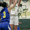 Nashoba Regional High School girls' basketball played Acton-Boxborough Regional High School on Thursday night in Bolton. NRHS's #11 Abby McNulty puts a shot up over ABRHS's #3 Charlotte Li. SENTINEL & ENTERPRISE/JOHN LOVE