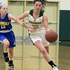 Nashoba Regional High School girls' basketball played Acton-Boxborough Regional High School on Thursday night in Bolton. ABRHS's #13 Lily Newcombe tries to stop NRHS's #11 Abby McNulty. SENTINEL & ENTERPRISE/JOHN LOVE