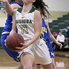 Nashoba Regional High School girls' basketball played Acton-Boxborough Regional High School on Thursday night in Bolton. NRHS's #11 Abby McNulty drives to the basket. SENTINEL & ENTERPRISE/JOHN LOVE