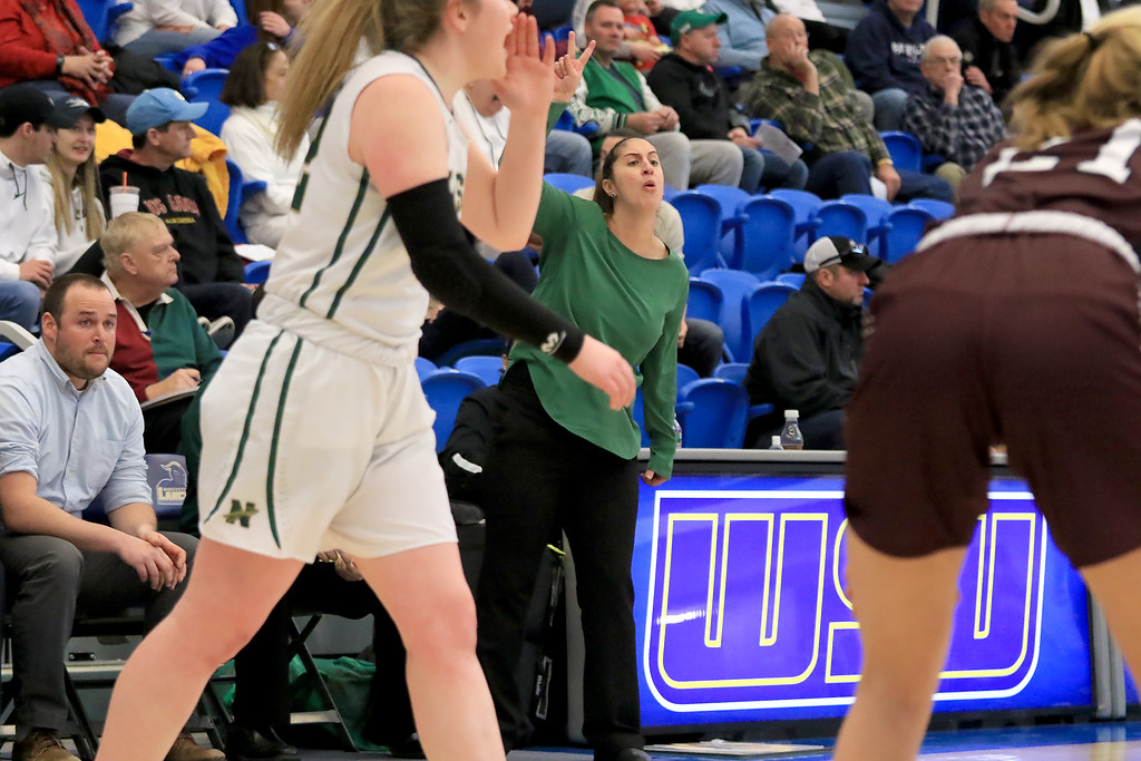 . Nashoba Regional High School beat Groton Dunstable Regional High School on Saturday, March 9, 2019 during the Girls Division II Championship game at Worcester State University. NRHS\'s coach Christina Seabury calls instructions from the sidelines during action in the game. SENTINEL & ENTERPISE/JOHN LOVE