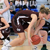 Nashoba Regional High School beat Groton Dunstable Regional High School on Saturday, March 9, 2019 during the Girls Division II Championship game at Worcester State University. GDRHS's Abigail Eisenklam and NRHS's Julia Roth go after a loose ball.  SENTINEL & ENTERPISE/JOHN LOVE