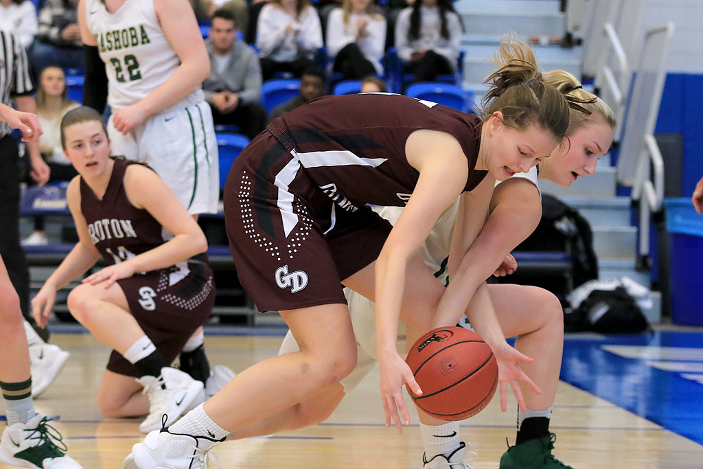 . Nashoba Regional High School beat Groton Dunstable Regional High School on Saturday, March 9, 2019 during the Girls Division II Championship game at Worcester State University. GDRHS\'s Abigail Eisenklam and NRHS\'s Julia Roth go after a loose ball.  SENTINEL & ENTERPISE/JOHN LOVE