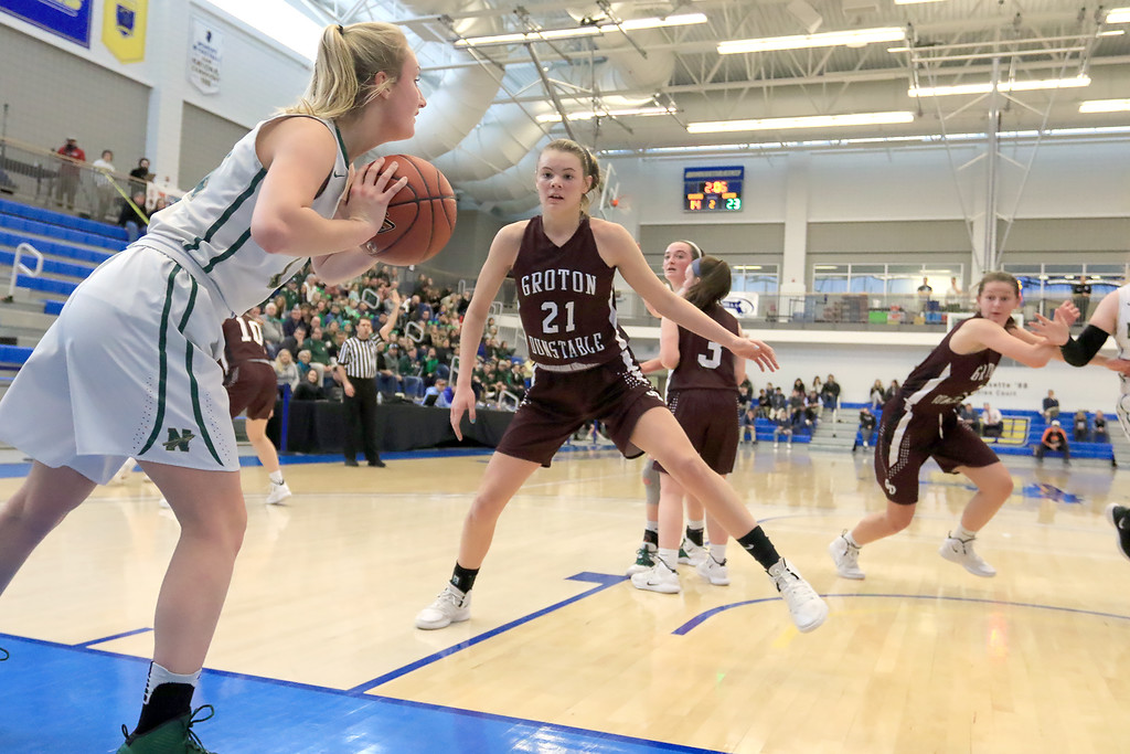 . Nashoba Regional High School beat Groton Dunstable Regional High School on Saturday, March 9, 2019 during the Girls Division II Championship game at Worcester State University. GDRHS\'s Bronwyn Mulligan covers an inbound pass by NRHS\'s Julia Roth. SENTINEL & ENTERPISE/JOHN LOVE