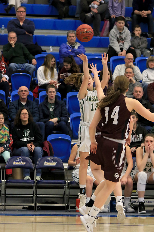 . Nashoba Regional High School beat Groton Dunstable Regional High School on Saturday, March 9, 2019 during the Girls Division II Championship game at Worcester State University. NRHS\'s Jillian Payne puts up a three point shot. SENTINEL & ENTERPISE/JOHN LOVE