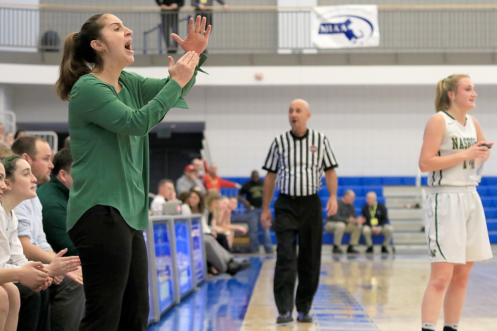 . Nashoba Regional High School beat Groton Dunstable Regional High School on Saturday, March 9, 2019 during the Girls Division II Championship game at Worcester State University. NRHS\'s coach Christina Seabury calls a timeout from the sidelines during action in the game. SENTINEL & ENTERPISE/JOHN LOVE