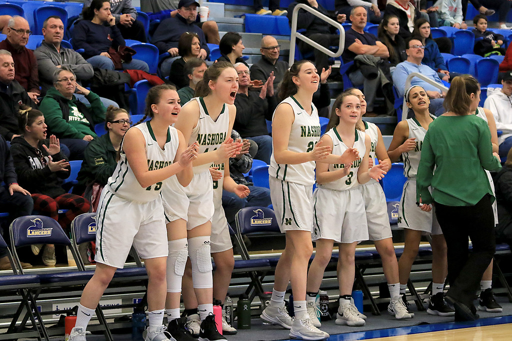 . Nashoba Regional High School beat Groton Dunstable Regional High School on Saturday, March 9, 2019 during the Girls Division II Championship game at Worcester State University. NRHS players cheer from the bench. SENTINEL & ENTERPISE/JOHN LOVE