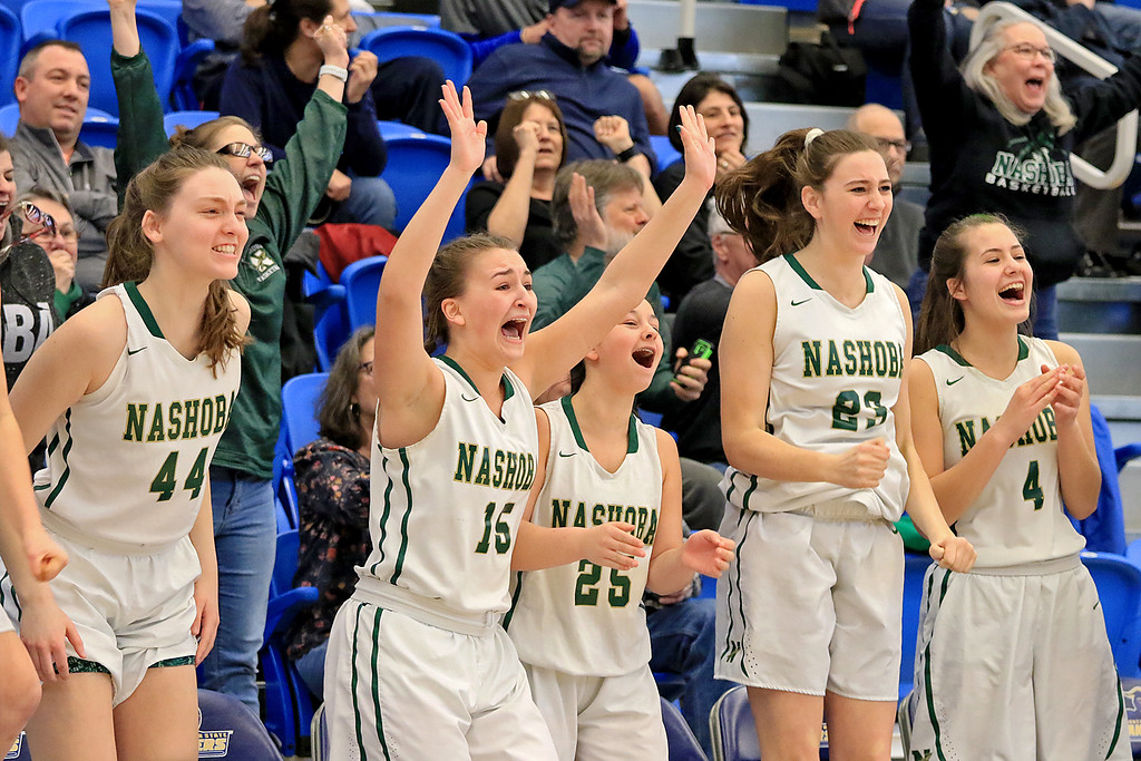 . Nashoba Regional High School beat Groton Dunstable Regional High School on Saturday, March 9, 2019 during the Girls Division II Championship game at Worcester State University. NRHS player cheer as a teammate scores in the last minute of the game. From left are Katelyn Burns, Grace Bolinsky, Emily Ramos, Hayley MacDonald and Shauna Curran. Nashoba won, 44-43. SENTINEL & ENTERPISE/JOHN LOVE