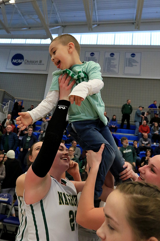 . Nashoba Regional High School beat Groton Dunstable Regional High School on Saturday, March 9, 2019 during the Girls Division II Championship game at Worcester State University. NRHS\'s coach Christina Seabury\'s son Patrick is lifted into the air by the team after their win. SENTINEL & ENTERPISE/JOHN LOVE