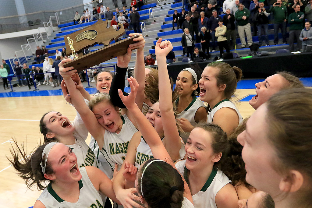 . Nashoba Regional High School beat Groton Dunstable Regional High School on Saturday, March 9, 2019 during the Girls Division II Championship game at Worcester State University. NRHS celebrates with the trophy.  SENTINEL & ENTERPISE/JOHN LOVE