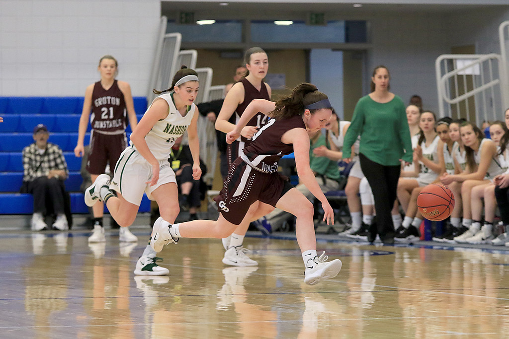 . Nashoba Regional High School beat Groton Dunstable Regional High School on Saturday, March 9, 2019 during the Girls Division II Championship game at Worcester State University. GDRHS\'s Emma Wilson takes off after a loose ball. SENTINEL & ENTERPISE/JOHN LOVE