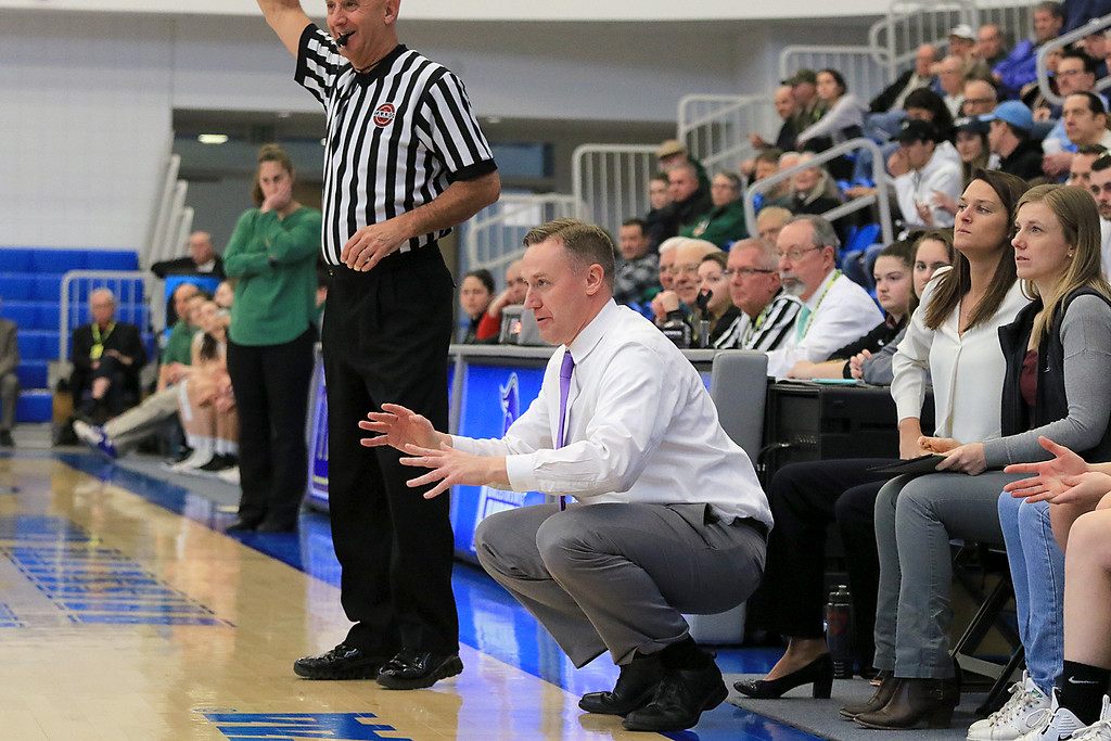 . Nashoba Regional High School beat Groton Dunstable Regional High School on Saturday, March 9, 2019 during the Girls Division II Championship game at Worcester State University. GDRHS\'s coach Mark Hennelly calls instructions from the sidelines.  SENTINEL & ENTERPISE/JOHN LOVE