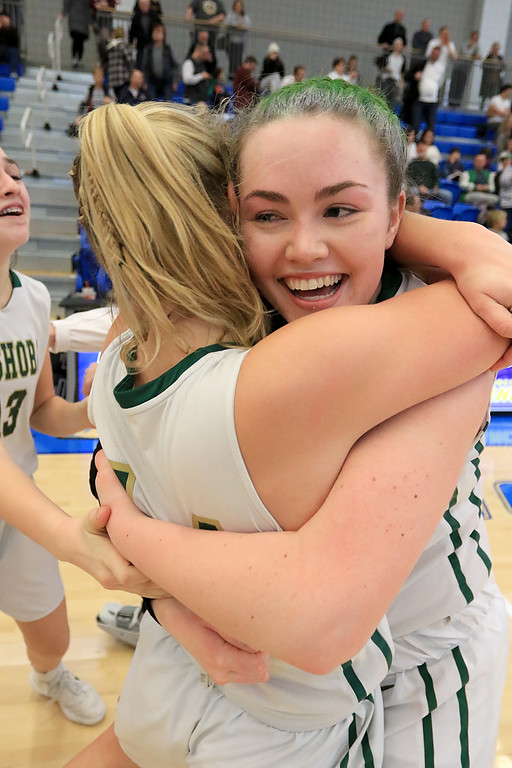 . Nashoba Regional High School beat Groton Dunstable Regional High School on Saturday, March 9, 2019 during the Girls Division II Championship game at Worcester State University. Brienne Donahue hugs a Shauna Curran as they celebrate their win. SENTINEL & ENTERPISE/JOHN LOVE