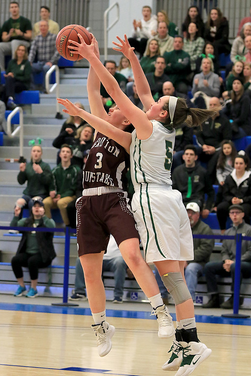 . Nashoba Regional High School beat Groton Dunstable Regional High School on Saturday, March 9, 2019 during the Girls Division II Championship game at Worcester State University.GDRHS\'s Emma Wilson and NRHS\'s Abigail Eisenklam go up for a rebound. SENTINEL & ENTERPISE/JOHN LOVE