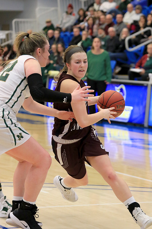. Nashoba Regional High School beat Groton Dunstable Regional High School on Saturday, March 9, 2019 during the Girls Division II Championship game at Worcester State University. GDRHS\'s Hannah Wynn charges to the net by NRHS\'s Brienne Donahue. SENTINEL & ENTERPISE/JOHN LOVE