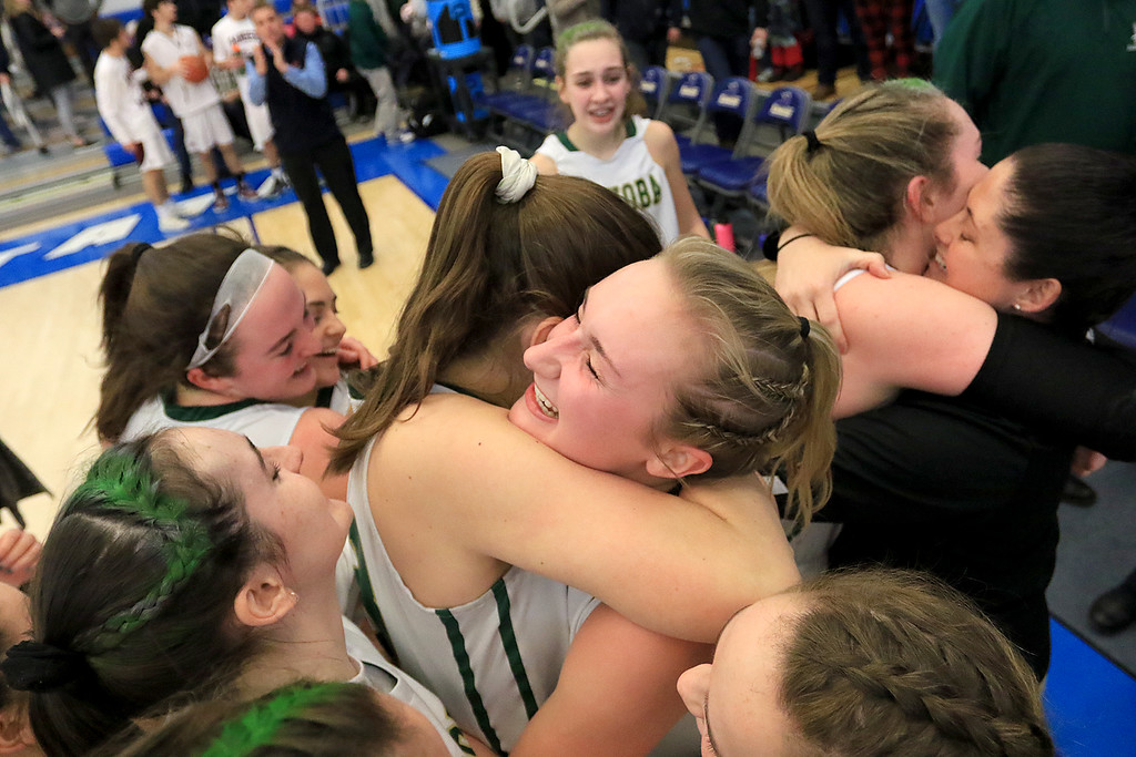 . Nashoba Regional High School beat Groton Dunstable Regional High School on Saturday, March 9, 2019 during the Girls Division II Championship game at Worcester State University. Teammates celebrate their win. SENTINEL & ENTERPISE/JOHN LOVE