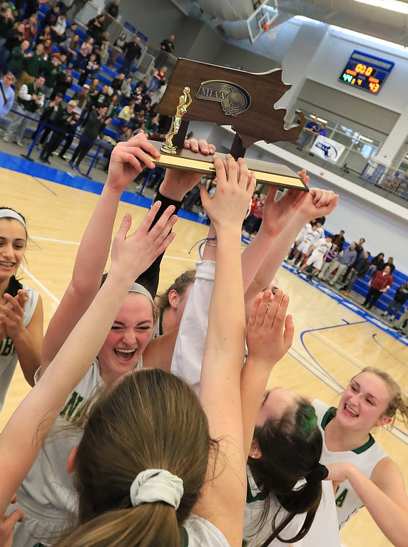 . Nashoba Regional High School beat Groton Dunstable Regional High School on Saturday, March 9, 2019 during the Girls Division II Championship game at Worcester State University. NRHS celebrates with the trophy. Holding the trophy is Alexis Richard. SENTINEL & ENTERPISE/JOHN LOVE