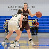 "Nashoba Regional High School beat Groton Dunstable Regional High School on Saturday, March 9, 2019 during the Girls Division II Championship game at Worcester State University.  NRHS""s Alexis richard covers Hannah Wynn as she brings the ball up court. SENTINEL & ENTERPISE/JOHN LOVE"