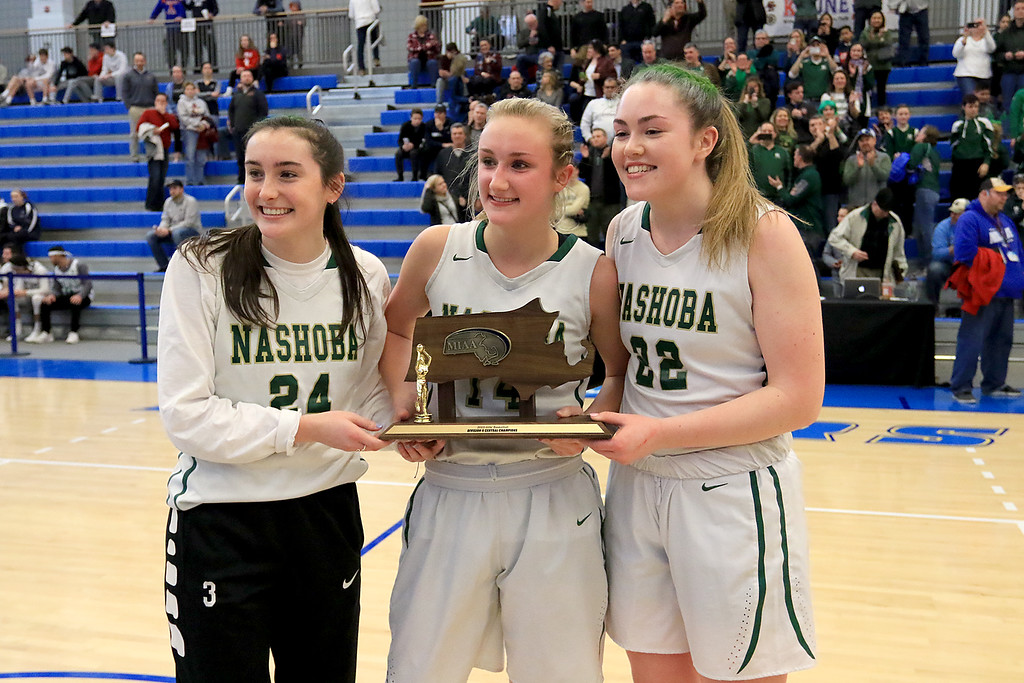 . Nashoba Regional High School beat Groton Dunstable Regional High School on Saturday, March 9, 2019 during the Girls Division II Championship game at Worcester State University. After getting their trophy NRHS players Holly Tremblay, Julia Roth and Brienne Donahue pose for some pictures. SENTINEL & ENTERPISE/JOHN LOVE