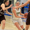 Nashoba Regional High School beat Groton Dunstable Regional High School on Saturday, March 9, 2019 during the Girls Division II Championship game at Worcester State University. NRHS'S Abigail McNulty drives to the basket by GDRHS's Hannah Wynn. SENTINEL & ENTERPISE/JOHN LOVE